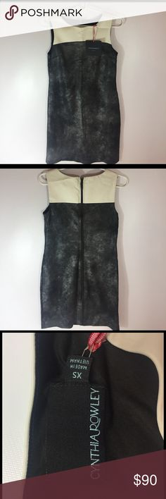 NWT Cynthia Rowley Dress Absolutely stunning Cynthia Rowley Dress! White faux leather on the top section. Zip back. Small XS. Cynthia Rowley Dresses