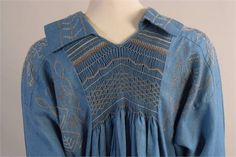 Lot 245 - A Vintage Blue Linen Smock Dress.