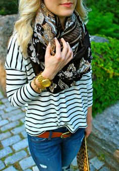 mixing patterns. Stripe dolman sleeve top with a patterned scarf. and we Love the front tuck!