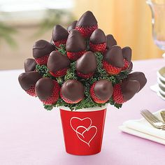 Reception Centerpieces? I love it. If you wanna go a more practical way...Instead of paying lots of money for flowers that will die, get a chocolate covered strawberry bouquet, that can be eaten. Yum!