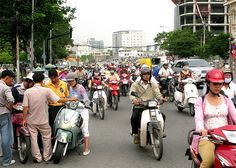 Saigon Scooters, Vietnam. This isn't rush hour in Ho Chi Minh City, but it will give you an idea of how many scooters there are here. At peak times, it isn't unusual to see gridlock. Needless to say, public transit is inadequate. (Rick Green photo.)