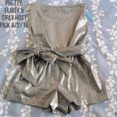 """Alice + Olivia Romper Size XS.  Gray romper with metallic sheen.  It tucks at the bust, has an elastic waistband, tie sash at waist and invisible side zipper.  Approximate measurements are 29"""" bust 28"""" waist and 32"""" hip.  58% Linen 20% Polyester 20 % Viscose 2% Lycra.  Negotiable, reasonable offers welcome.  Use the offer button.  No trades/no PayPal. Alice + Olivia Pants Jumpsuits & Rompers"""