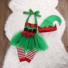 This+romper+is+super+adorable+for+your+little+Christmas+elf,+comes+in+an+adorable+elf+design+with+green+sewn+tutu+full+skirt+around+the+entire+romper,+lined+for+comfort,+includes+leg+warmers+and+hat. 0/6+months,6/12+months-+12/18+months,18-24 if+worried+about+the+size+order+a+size+up+<3