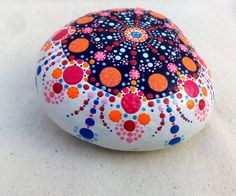 I really like this pattern using black on white. Dots Mandala painted rock Meditation Pebbles by ColorBakalito