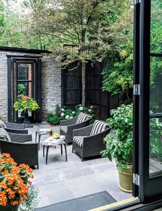 Outside livingroom - Landscape Inspiration: A Dozen Lush & Lovely Townhouse Backyards