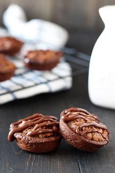 Chocolate Pecan Tassies feature a chocolate cookie shell stuffed with a gooey yet crunchy pecan filling and drizzled with more chocolate. YUM.