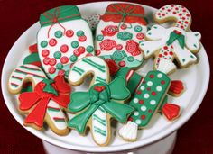 So fun and colorful Christmas cookies to kick off the holiday season. A friend of mine requested holiday cookies so I made some candy jars, candy cane cookies, and some wrapped candy cookies....
