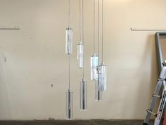 Chandeliers • Consign Lighting and Furniture • The Local Vault Luxury Chandelier, Chandeliers, Vaulting, The Locals, Wind Chimes, Lighting, Outdoor Decor, Furniture, Home Decor