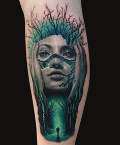 a 3D tattoo of a face split into several parts on the dark wood background