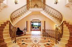 The grand entrance - double staircase enhances the overall grandeur of this house