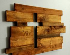 "Each piece is unique and made to order. These beautiful rustic pieces are generally made of oak, cedar pine and reclaimed wood . Imperfections add to the character and charm of the pieces. We hand select and arrange the pieces to achieve just the right mix of color, texture and character. The thickness is generally ¾"" but widths vary. Each cutout is finished with Danish Oil to bring out the character in the wood. Hangers are added to the back to allow easy hanging.  We would love to…"