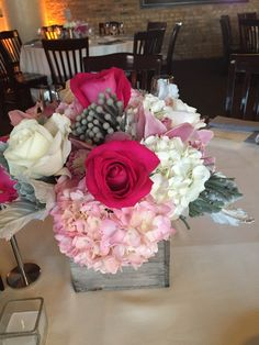 Ashland Addison never disappoints with their floral arrangements! We love the pink color scheme. Photo taken by River Roast