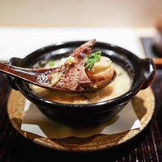 槍烏賊の小鍋 菜の花 豆腐 椎茸 Small hot pot of Yari-Ika (spear squid) broccoli flower tofu and Shiitake mushroom // a small hot pot is a classical dish at Ishikawa served right before the rice dish. Although there's no luxurious ingredients in the soup but basically squid and spring vegetables the umami white miso soup that soaked up all the essence of the squid was unforgettable. - 石かわ Ishikawa #MissNeverfull_Tokyo by miss_neverfull