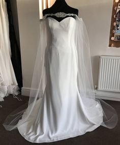 This tulle full length cape measures approximately 70 from the top of the trim to the end. The neckline is embellished with a diamante applique & the shoulders & back are wrapped with a silver beaded trim, no need for fastners as it just pops over your head. It has a fine elastic