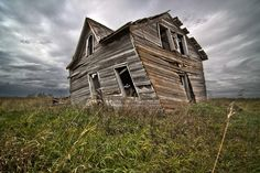 my unfulfilled ambition is to drive cross country and photograph dying farmhouses/barns. Old Buildings, Abandoned Buildings, Abandoned Places, Haunted Places, Crooked House, Old Farm Houses, Old Churches, Famous Photographers, Old Barns