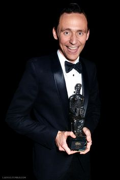 Tom Hiddleston wins Best Actor Award for Coriolanus at the 60th London Evening Standard Theatre Awards at the London Palladium on November 30, 2014 in London, England.