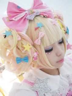 I'm assuming this is a nice wig. Love the bows.