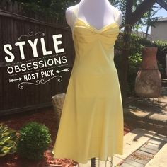 Calvin Klein halter yellow & white dress Calvin Klein 100% polyester dress.  Fully lined.  Zipper and hook closer.  Yellow with a white band with sequence around neckline (which is a halter and Cris-cross in the back).  Dress is mid-length.  There is a small stain after dry cleaning ... Can be seen in the 4th picture, otherwise dress is perfect.  Worn once. H O S T  P I C K!  StYlE ObSeSsIoNs 06/26/2016 Calvin Klein Dresses