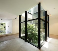 A  tree well offers a bit of greenery within the minimal space.
