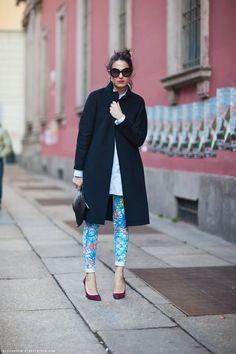 Alex in the black coat, white shirt, printed pants and burgundy stilettos.