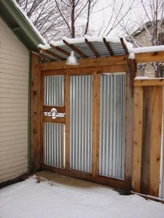 Sliding Gate Of Cedar And Corrugated Steel Roofing. With Little Roof To  Keep The Snow