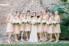 Bridesmaids in blush in the courtyard of the French Huguenot Church Bridal Suite in Charleston, SC // Aaron and Jillian Photography