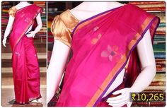 Dress up in this sparkling rani pink uppada silk saree with blue border and floral motifs and look wonderful.