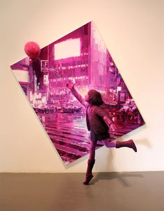 Japanese artist Shintaro Ohata places his colorful sculptures in front of a similar backdrop in order to give the illusion of one art piece.