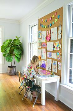 Family room sidewall. Cork board to display kids' art and small desk area for home work and craft area.