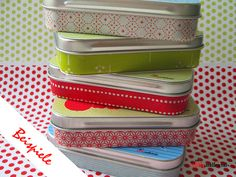 using decorative paper and tape to decorate tins