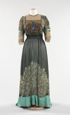 """Evening Dress, Weeks: 1910, French, silk, metal. """"Associated with royalty and symbolizing beauty, immortality and exoticism, the peacock has long been a favorite motif of artists. Particularly during the Art Nouveau movement, designers incorporated the birds into their work, inspired by the creatures' sinuous bodies and showy feathers."""""""