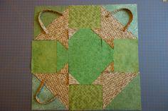 Kori-blokki, koko n. 33 cm x 33 cm, kappaleet leikattu, ei vielä ommeltu. Kolmioita, neliöitä, täysvinokaitale. Kevät 2015