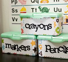 Using wrapping paper and labels on plastic bins is a fun way to get organized for activities and homework. These were once baby wipe bins that have been recycled.