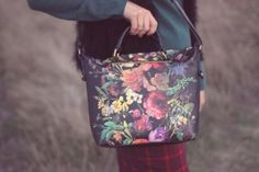 Featuring a colorful and chic midnight floral, carry these styles with you all season.  Photo Credit: Laura Jean Atelier