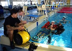 171207-N-NM917-088  YOKOSUKA, Japan (Dec. 7, 2017) Operations Specialist 2nd Class Chris Nash, left, assigned to guided-missile destroyer USS Benfold (DDG 65), holds safety line during Search and Rescue (SAR) training with Afloat Training Group West Pac at Commander, Fleet Activities Yokosuka. SAR swimmers play a key role in personnel safety and mission readiness of U.S. Naval Operations. (U.S. Navy photo by Mass Communication Specialist 2nd Class Jordan Kirkjohnson/Released)