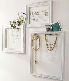 Great way to keep necklaces untangled and on display.  Maybe frame cork and use fancy straight pins.