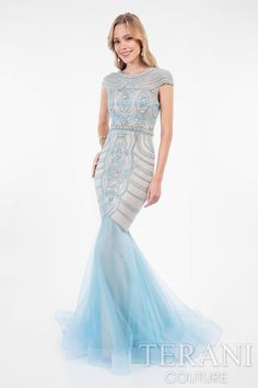 Sumptuous light blue, trumpet designer dress featuring intricate bead-work along its cap-sleeves down to its trumpet skirt. A lavish mix of crystals, beads and pearls create a unique scroll and scallop motif for a red carpet ready special occasion dress for your high school prom or formal event. This formal gown from our prom collection is finished with a luxurious train.