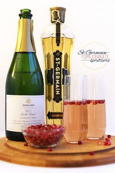 German Pomegranate Spritzers | Minamilist BakerA simple yet delicious spritzer compromised of a Brut sparkling white wine, a shot of St. Germain, pomegranate juice and arils and a dash of club soda.