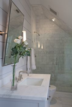 Great loft bathroom space. Made to measure frameless glass to fit space and give illusion of one space. Wet room style. TINY showered.