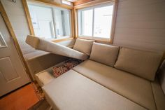 Couch Storage with room to relax and spread out - Custom Tiny House by Big Freedom Tiny Homes