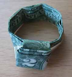 wikiHow to Fold a Dollar Bill to Make a Finger Ring -- via wikiHow.com