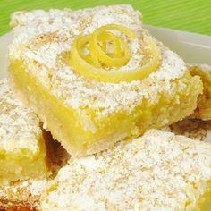 Light refreshing delicious lemon bars will disappear off the serving plate.. Lemony Fresh Lemon Bars Recipe from Grandmothers Kitchen.