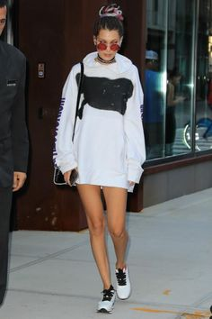Bella Hadid wearing Fallon Monarch Graduated Skinny Silk Bandana in Black, Christian Dior Mini Diorever Bag, Sunday Somewhere Valentine Sunglasses and Brashy Expressionism Hoodie