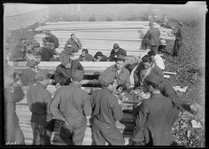 `Pine table' in use at CCC Camp, TVA #22, near Esco, Tenn. The lumber on which these boys are having their noon meal will be used to build the barracks which they will occupy this winter, November 1933 | Photographer: Louis Wickes Hines (pinned by haw-creek.com)