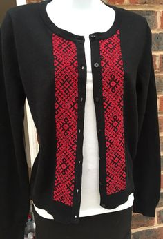 Beautiful red cross stitch detail added to a black cardigan to give a unique stylish look that cant be bought on the high street!  Once youve