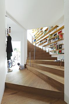 Modern Japanese home with continuous wooden staircase | Eames coat rack and armchair with wood dowel base | via Dwell (dwell.com)
