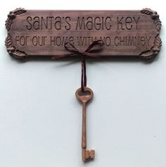 Christmas CNC Project:  Santa's Magic Key Sign designed in Vectric Software cut in Walnut and Oak