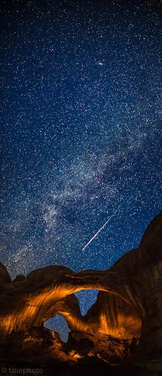 Perseid meteor streaking over the lightpainted double arch in Arches National Park. | Flickr - Photo Sharing!