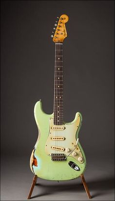 """This is a very cool, and very rare Fender Custom Shop Strat masterbuilt by renowned luthier john Cruz. Inspired by Jeff Beck's Surf Green Strat, this piece features a  lightweight alder body, with a Heavy Relic'd Surf Green over 3-Tone  Sunburst finish, maple neck with the Beck """"C"""" carve, 9.5""""..."""