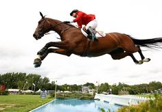 Madden perfectly clears the water jump during the Longines King George V Gold Cup at the Longines International Horse Show at Hickstead on July 26, 2009 in Sayers Common, England.